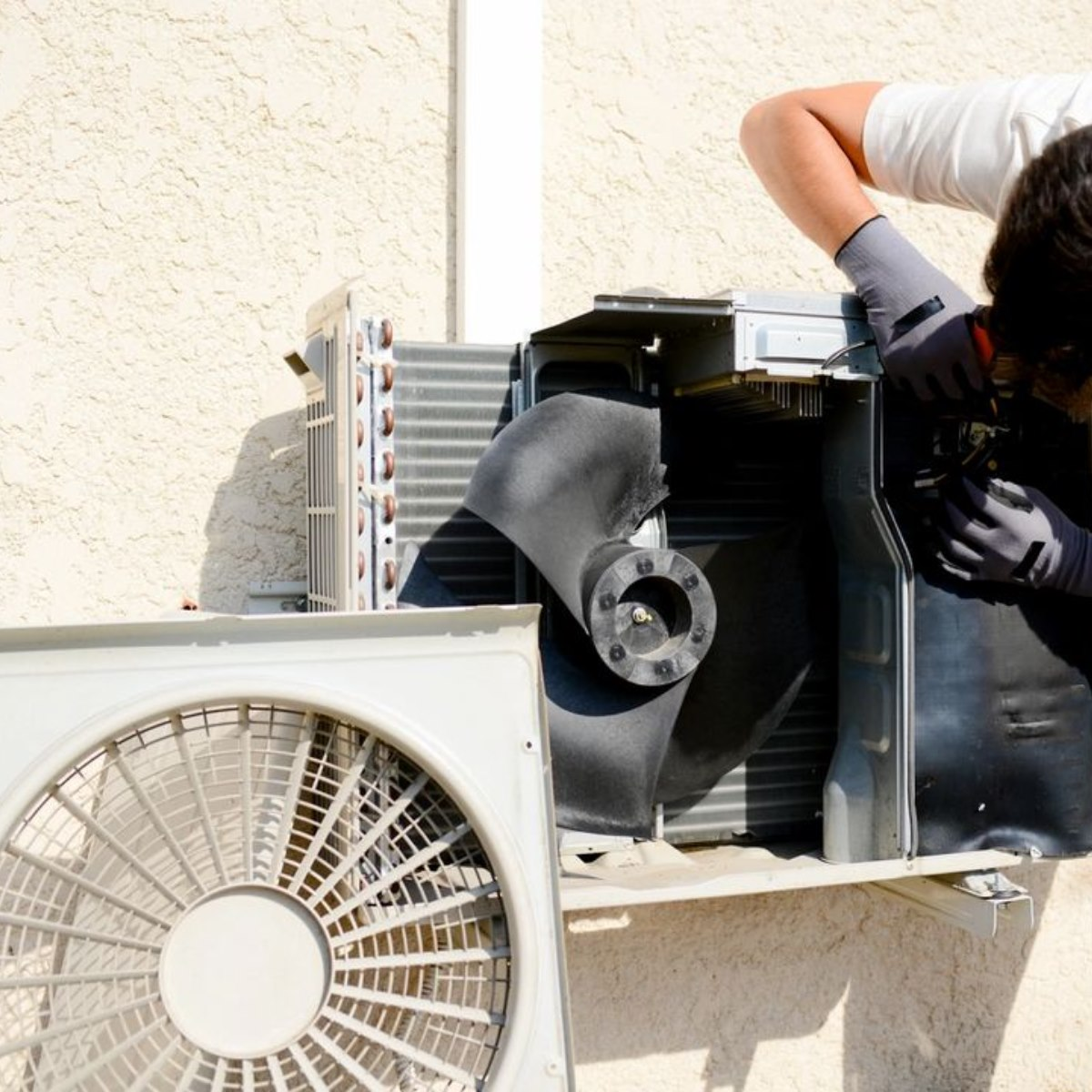 Outdoor ac unit being services